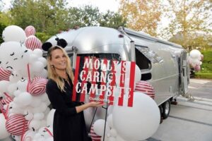 "Cool Mom Surprised Her Family With A Driveway ""Carnevil Campsite"" in an Airstream With Help From  Outdoorsy.com"