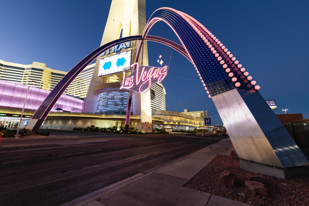 LLUMINATED GATEWAY ARCHES WELCOME VISITORS TO DOWNTOWN LAS VEGAS